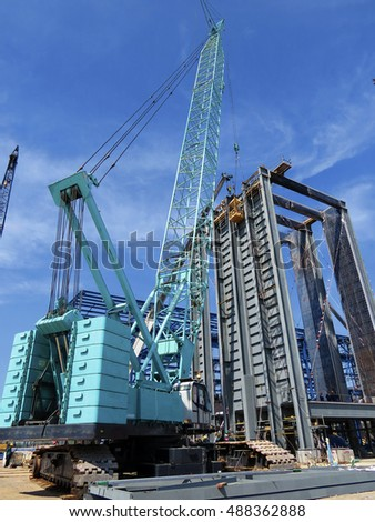 Hydraulic Crawler Cranes in Construction site and blue sky day