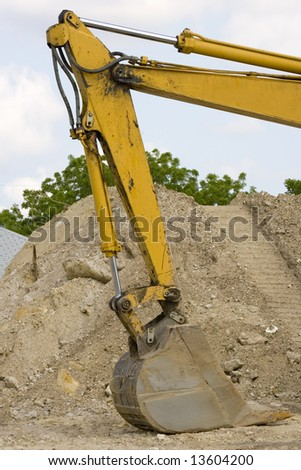 Hydraulic cylinders are the backbone of a backhoe - stock photo