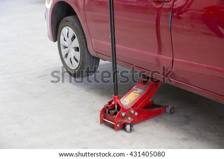 Hydraulic floor jack. - stock photo