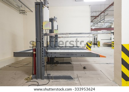 Hydraulic lifts for the car in the underground parking.