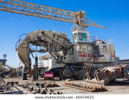 Hydraulic Mining Excavator at the repair plant - stock photo