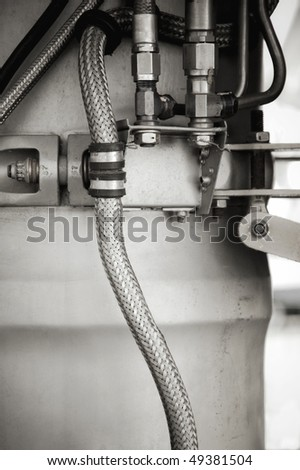 hydraulic pipes and components inside an aircraft jet engine - stock photo