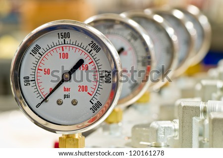 Hydraulic Pressure Gauges installed on Hydraulic Equipment - stock photo