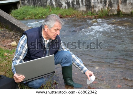Hydro-biologist testing quality of water - stock photo