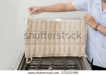 Hydrocollator Moist Heat Packs,Medical equipment for physical therapy - stock photo