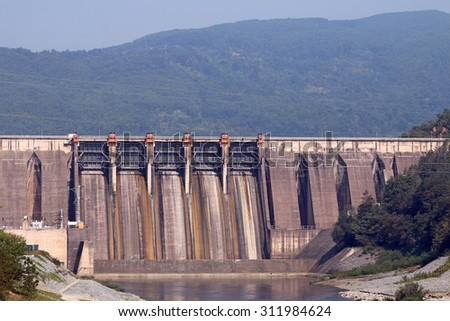 hydroelectric power plants on river - stock photo