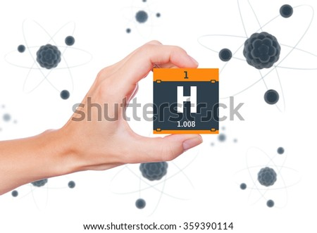 Hydrogen element symbol handheld and atoms floating in background - stock photo