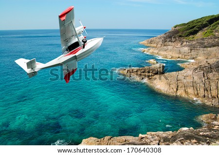 hydroplane  flying  over beauty rock-beach Indian Ocean in Thailand, concept excursion on  airplane - stock photo