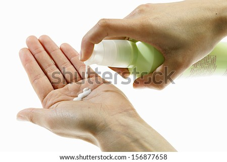 Hygiene and beauty, put the moisturizer in hand - stock photo