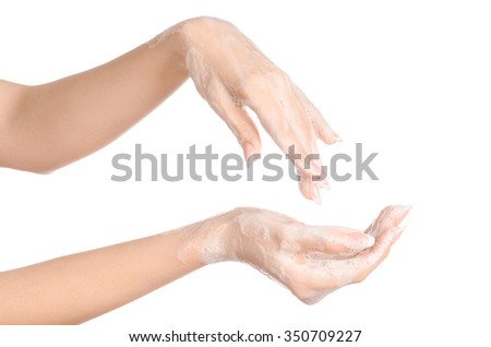 Hygiene and health protection topic: a woman's hand in soapsuds isolated on white background in studio