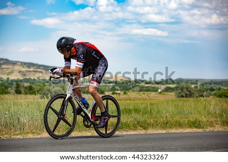 Hygiene, CO, USA - June 25, 2016: A cyclist rides along Hygiene Road while competing in the Hygiene Time Trial north of Boulder.