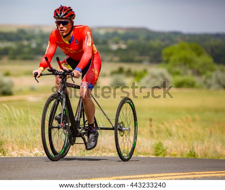 Hygiene, CO, USA - June 25, 2016: An adaptive cyclist competes in the tricycle category at the Hygiene Time Trial north of Boulder.
