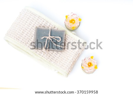 hygiene soap bar with wisp and candles . Spa background. Bath herbal toiletries for beauty, wellness, health. Scented natural cosmetics for body care, clean, wash. Aromatic freshness - stock photo