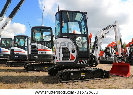 HYVINKAA, FINLAND - SEPTEMBER 11, 2015: Lineup of Bobcat compact excavators with E20 on the front on display at MAXPO 2015.  - stock photo