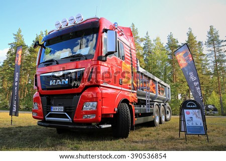 HYVINKAA, FINLAND - SEPTEMBER 11, 2015: New MAN TGX D38 35.560 tipper truck for construction on display at the exhibition for land construction and environmental maintenance machines MAXPO 2015. - stock photo