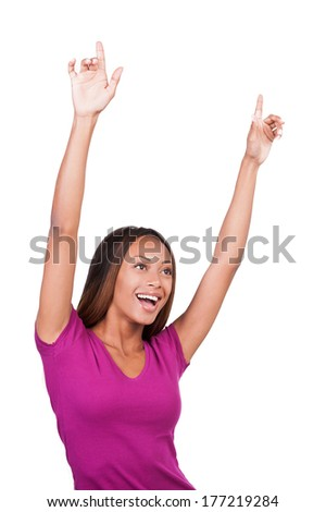 I am a winner! Attractive young African woman keeping her arms raised and expressing positivity while standing isolated on white  - stock photo