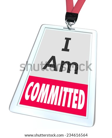 I Am Committed words on an employee name badge or ID card or tag to illustrate dedication to the job and determination to complete a task or work