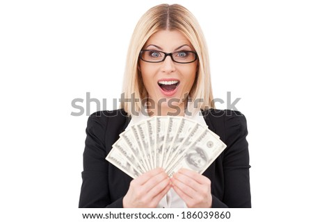 I am rich! Happy mature businesswoman holding money in her hands and smiling while standing isolated on white - stock photo