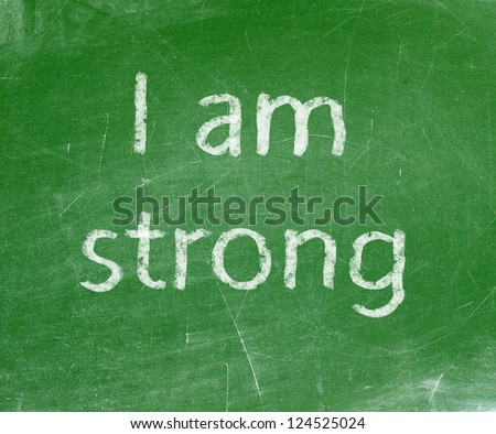 I am Strong handwritten with white chalk on a blackboard. - stock photo