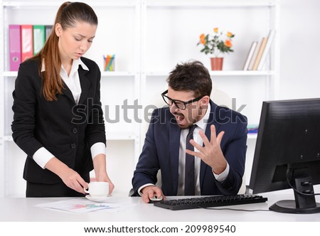 I asked to bring me tea! Stressed young businessman shouting at his secretary holding a cup of coffee - stock photo