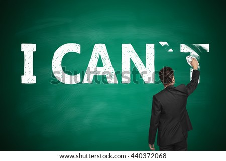 I can, self motivation concept. Businessman wiping letter 'T off chalkboard so that it reads i can - stock photo