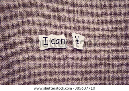 I can self motivation - torn letter t of the written word I can't  - stock photo