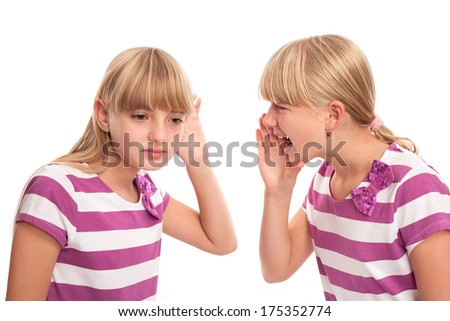I can't hear concept - Girl shouting to another girl who can't hear well. Isolated on white. - stock photo