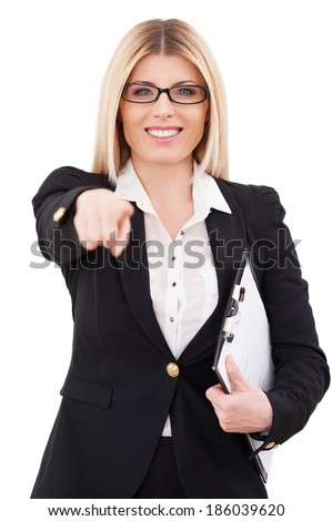I choose you! Cheerful mature businesswoman pointing you and smiling while standing isolated on white - stock photo