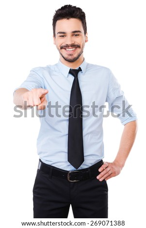I choose you! Handsome young man in shirt and tie pointing you and smiling while standing against white background - stock photo