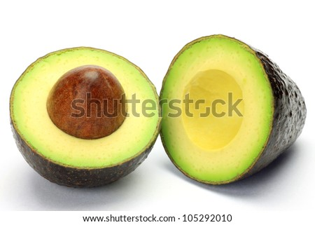 I cut avocado to half and took it in a white background. - stock photo