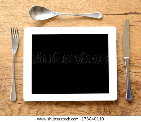 i eat technology for breakfast concept, screen isolated black for copy space - stock photo