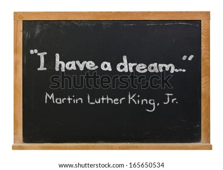 I have a dream and Martin Luther King, Jr. written in white chalk on a black chalkboard isolated on white - stock photo