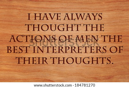 I have always thought the actions of men the best interpreters of their thoughts - motivational quote by John Locke on wooden red oak background - stock photo