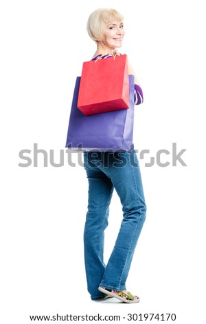 I like shopping! Happy middle aged woman  holding shopping bags. Isolated on white background - stock photo