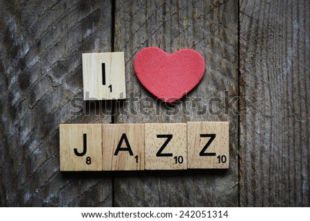 I love jazz Concept. Red heart and Wooden Scrabble letters spelling I love jazz Concept. - stock photo