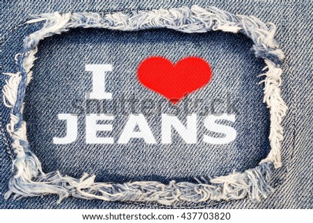 I LOVE JEANS on destroyed torn denim blue jeans patch background, close up - stock photo