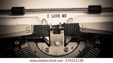I Love Me concept on typewriter  - stock photo