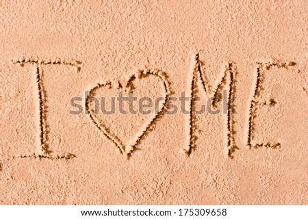 I love me written on wet sand - stock photo