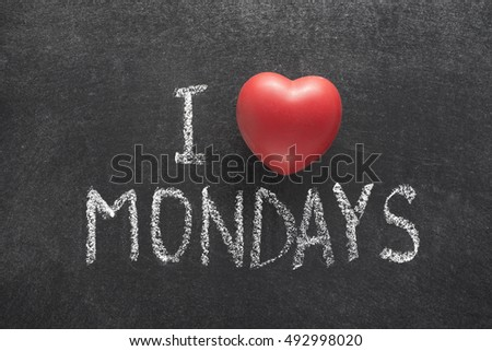 I love Mondays phrase handwritten on chalkboard with heart symbol instead of O
