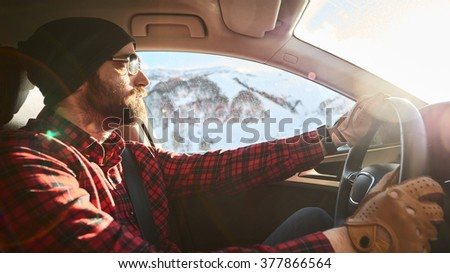 I love my car! Focused young man driving his car  - stock photo
