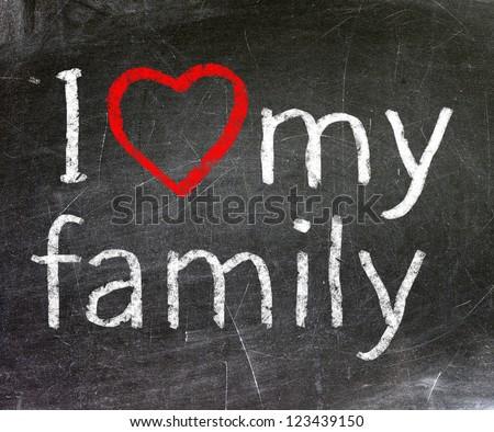 I love my family handwritten with white chalk on a blackboard. - stock photo