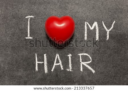 I love my hair phrase handwritten on blackboard with heart symbol instead of O