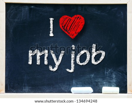 I love my job handwritten with white chalk on a blackboard. - stock photo