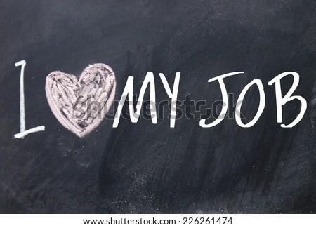 I love my job text write on blackboard - stock photo