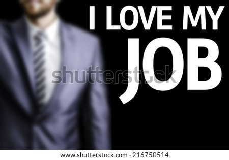 I Love My Job written on a board with a business man on background - stock photo