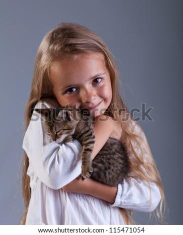 I love my kitten - little girl holding her new pet - stock photo