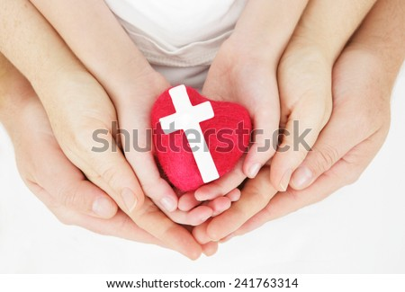 I love our faith - family hands holding heart and cross - stock photo