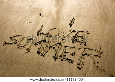 I love summer written on a sandy beach - stock photo