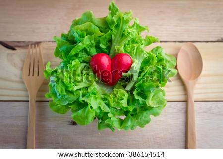 I love vegetables,vegetarian. Vegetarian food heart shape. - stock photo