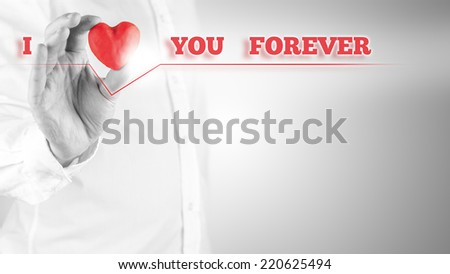 I Love You Forever inspirational emotional message in red on a virtual screen with a man holding a symbolic heart to represent the word love, with copyspace for a greeting to a sweetheart. - stock photo